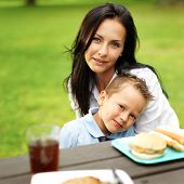 mom and son hugging at picnic table