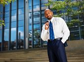 business executive in front of office building portrait