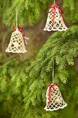 Christmas lace bells with red ribbons