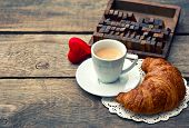 Cup Of Black Coffee With Croissant And Red Heart