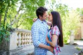 Amorous travelers embracing outdoors