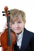 pic of young boy  - young boy dressed up for his recital holds his violin - JPG