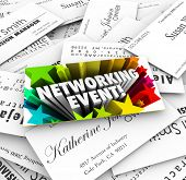Networking Event words on a business card on a stack of contacts collected at a mixer, meeting, semi