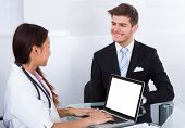Businessman Consulting Doctor