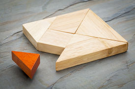foto of tangram  - a missing piece in a square built from tangram shapes - JPG