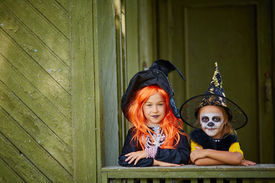 pic of antichrist  - Portrait of two Halloween girls in costumes looking at camera - JPG