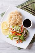 Rice Noodles And Vegetable Salad With Squid Vertical Top View