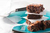 image of brownie  - Chocolate Fudge brownies served on a blue plate - JPG