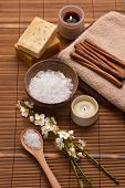 Spa setting with candle,towel, soap,cinamon. with mat