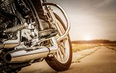foto of bottom  - Biker girl riding on a motorcycle - JPG