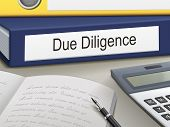 pic of diligent  - due diligence binders on the office table - JPG
