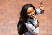 stock photo of goodbye  - overhead view of african american student waving goodbye - JPG