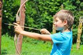 pic of shoot out  - The kid shoots a bow in the park - JPG