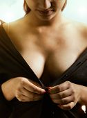 picture of undressing  - Beautiful sexy girl in black dress undressing herself - JPG