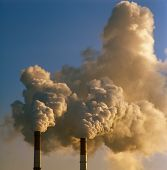 picture of smog  - Air pollution by smoke coming out of two factory chimneys - JPG