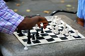 Two men playing chess in a park