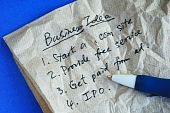 Write some creative business idea on a tissue isolated on blue