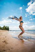 Pretty Slim Woman With Black Pareo Posing On The Beach
