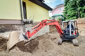 foto of rebuilt  - A big family house is being rebuilt with the help of an excavator - JPG