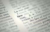 stock photo of justice law  - The word law from the dictionary showing a very shallow depth of field - JPG