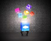 Man Holding Cloud Box Illuminated App Icons With Brick Wall