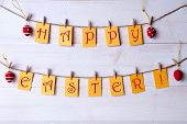 pic of egg whites  - Yellow Labels With Red English Text Happy Easter Hanging On A Line With Four Red And White Dotted And Striped Easter Eggs White Wooden Vintage Or Rustic Background For Easter Greetings - JPG