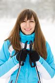 Young Caucasian Woman Skiing At Winter Outdoor.