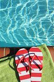 flip flops by pool side