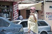 Elderly Fisherman In The Street