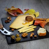Solid Cheeses Plate: Dutch Solid Cheese, Olives And Walnuts