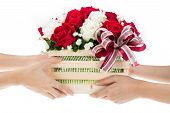 image of gift basket  - Hand delivers baskets of red and white rose flowers as a gift isolated on white background - JPG