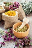 Healing Herbs In Wooden Mortar And In Hessian Bags, Herbal Medicine.