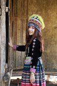 image of hmong  - Traditionally dressed Mhong hill tribe woman in the wooden cottage