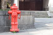 Red Fireplug Standing On Footpath