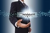 Businessman hand showing project button