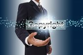 Businessman hand showing copyright button