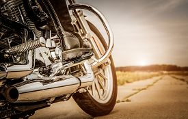 stock photo of biker  - Biker girl riding on a motorcycle - JPG