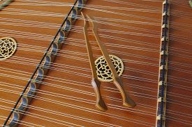 picture of celtic  - Patterns, lines and Celtic Knot themes high light this still of a dulcimer with the hammers positioned artistically on the strings. Golden hues emphasize the detail of this beautiful instrument. ** Note: Visible grain at 100%, best at smaller sizes - JPG