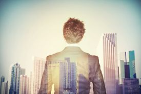 picture of economy  - Businessman aspires to success in the economy - JPG