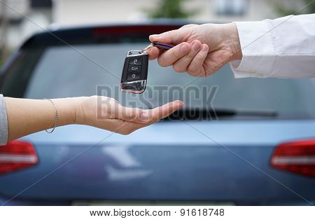 poster of Car Dealer Gives The Customer The Car Keys With Car In Backgorund