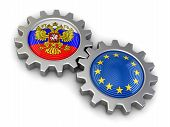 foto of snatch  - Russian and European union flags on a gears - JPG