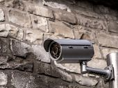 stock photo of cctv  - Security cctv camera fixed to the wall - JPG