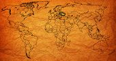 picture of flags world  - ukraine flag on old vintage world map with national borders - JPG