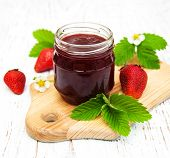 stock photo of strawberry  - Strawberry jam and fresh strawberries on a wooden background - JPG