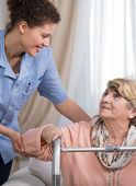 picture of physiotherapist  - Careful young female physiotherapist and older disabled woman  - JPG