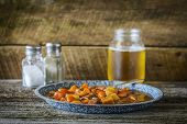 pic of stew  - Plate of hearty beef stew on a rustic background - JPG