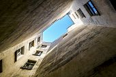 image of quadrangles  - Views of the blue sky from the courtyard of the well in Saint Petersburg Russia - JPG