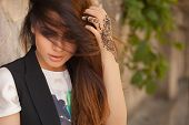 foto of mehendi  - Portrait of a young indian woman in casual style with mehendi on the streets of old city - JPG