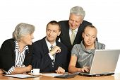 stock photo of work crew  - Business people at work with laptop on a white background - JPG