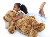 Beautiful Six Year Old Girl Laying Down In Pajamas With Bear poster